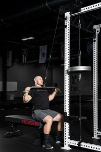 The Rogue Monster Slinger can add a band, plate or weight stack cable pulley to your Monster series power rack.