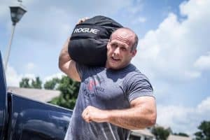 Sandbags can be shouldered - this is an intense workout.  The Rogue sandbag is unique in that it can be loaded very heavy.