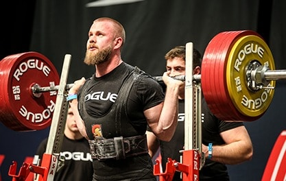 A power bar is commonly used for powerlifting - it's a thicker bar than normal (29mm) with no flex or whip and includes center knurl.
