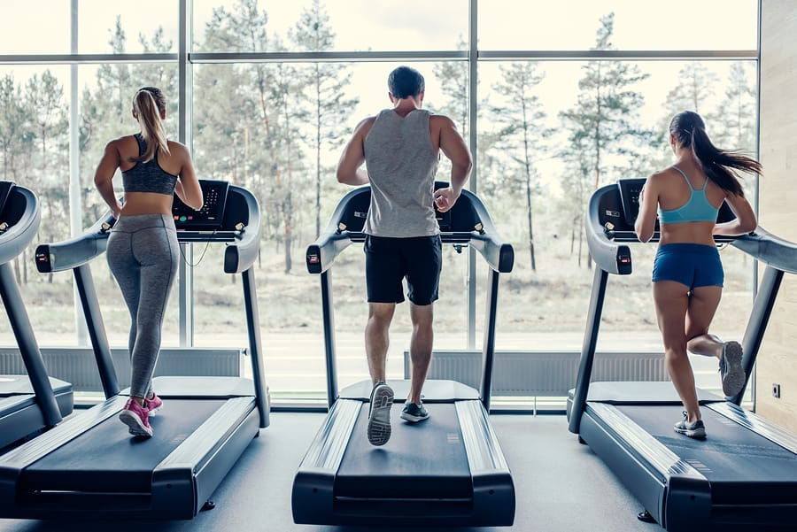 Treadmill in a gym - running on the treadmill is one way to improve physical fitness in the gym or at home.