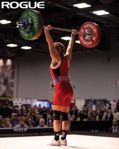 USA Weightlifting- a competitor on the platform sporting weightlifting shoes with a raised heel