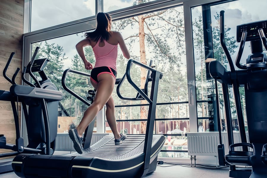 Running on a curved treadmill in the gym