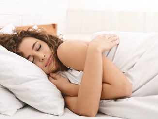 Woman sleeping - timely sleep may be an essential part of maintaining a healthy weight.