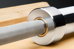 Combining a stainless steel, 200,000 PSI tensile strength shaft with chrome sleeves and quality needle bearings, this version of the Rogue Pyrros Women's Olympic WL Bar ranks among the best in the industry for feel, durability, and performance. Each 15KG bar is machined and assembled in Columbus, OH, and includes an exclusive Rogue knurl pattern that's precision-cut for a firm grip without the sharpness or abrasiveness of many import bars.